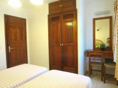 Main bedroom with aircon, built-in wardrobe, dressing table, safe
