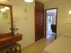 Second bedroom (twin) with aircon, built-in wardrobe, dressing table, mirror