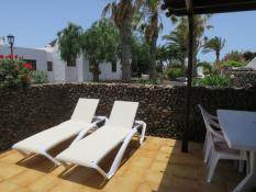 Private sun terrace with outdoor dining area, BBQ, sun loungers and parasol